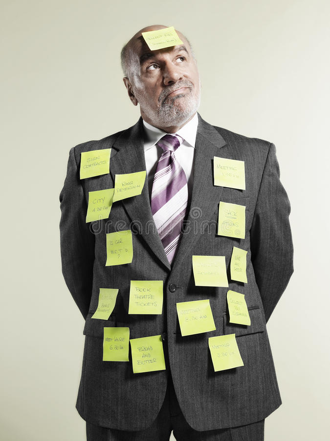 Businessman Covered With Adhesive Notes royalty free stock photo