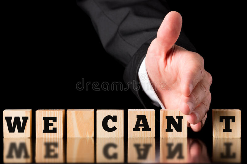 Businessman Creating Positive Saying from Blocks royalty free stock photography