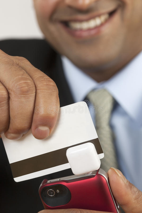 Businessman with credit card swiper royalty free stock images