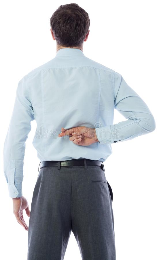 Businessman crossing fingers behind his back stock photo