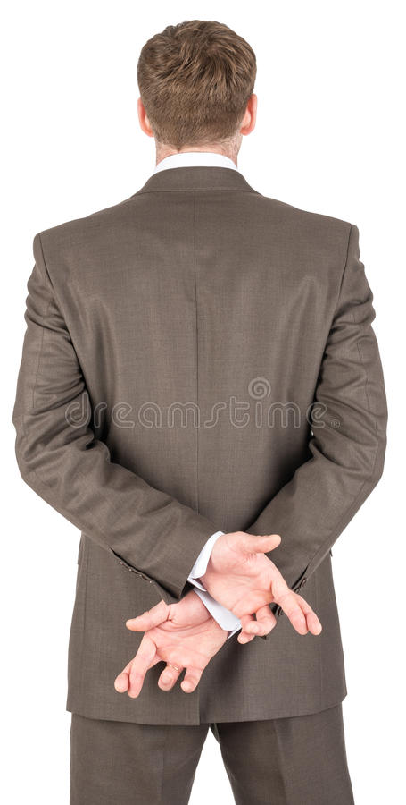 Businessman crossing fingers behind his back royalty free stock photos