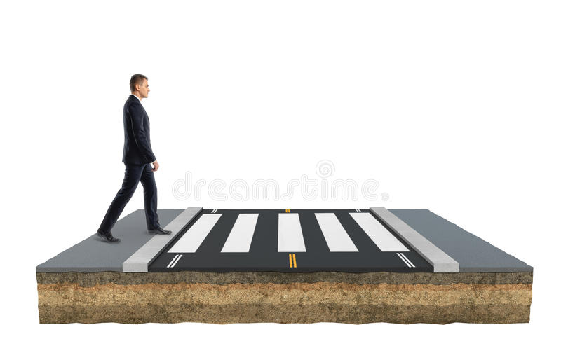 Businessman is crossing road on footpath moving forward royalty free stock image