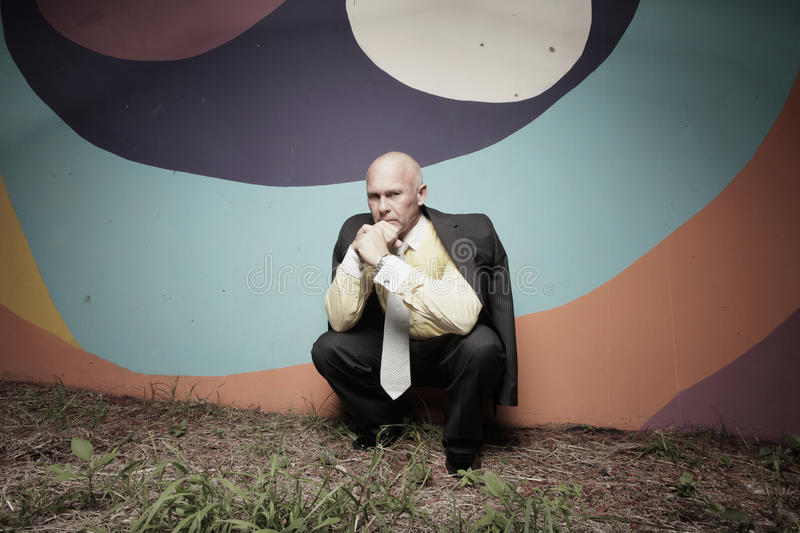 Businessman Crouching In The Dark Stock Images