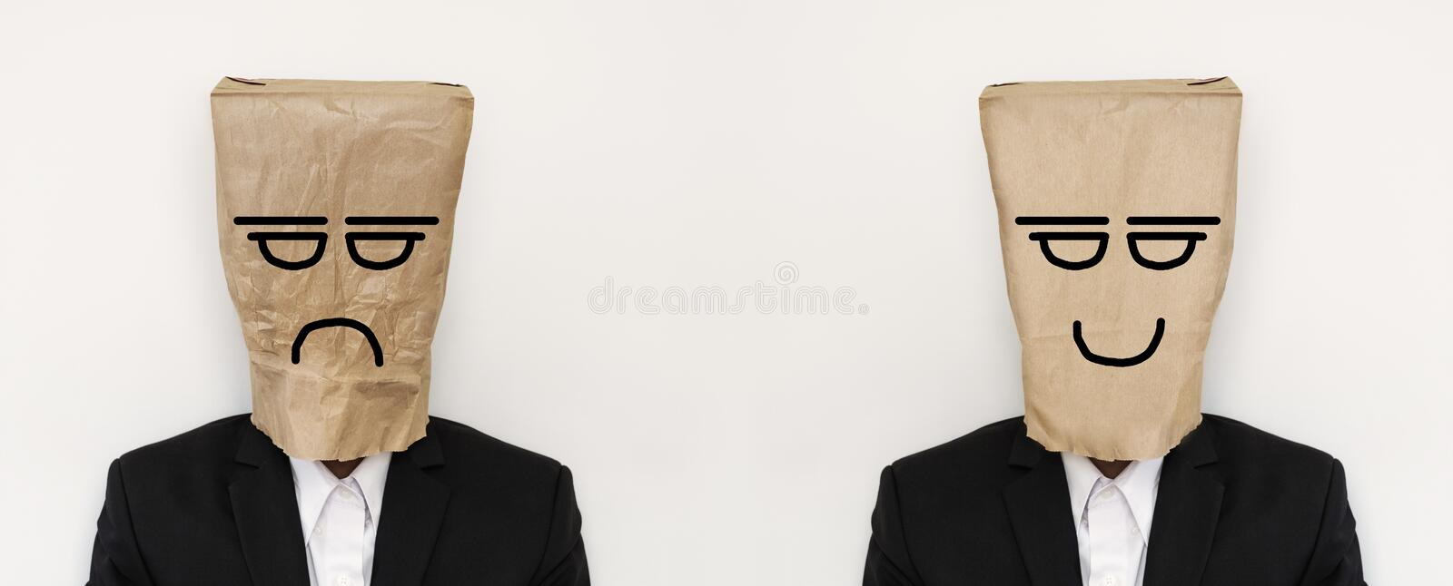 Businessman with crumpled paper bag with anger bored face, and smooth paper bag with smiling face stock photo