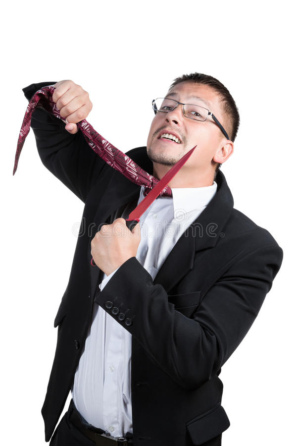 Businessman cut his tie. Man in suit and glasses knife cuts off his tie isolated on white background royalty free stock images