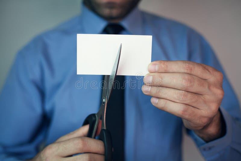 Businessman cutting card. royalty free stock photo