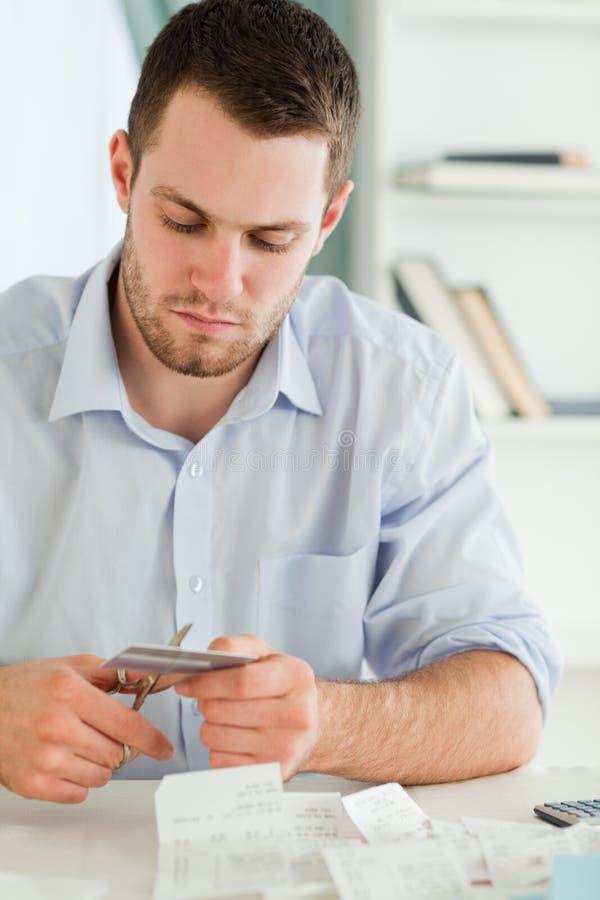 Businessman cutting his credit card stock photos