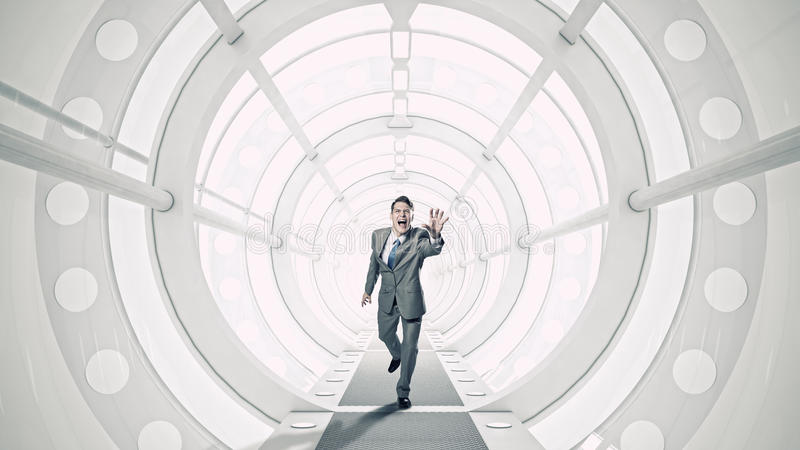 Businessman in 3D room . Mixed media royalty free stock images