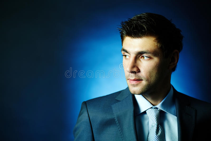 Businessman in darkness