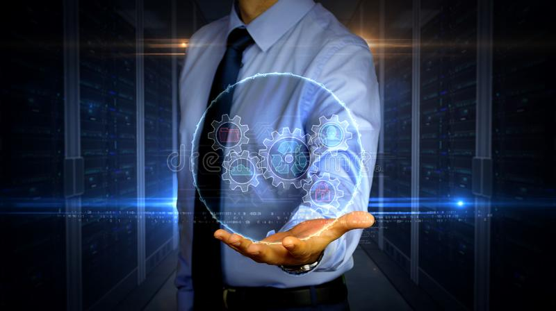 Businessman with data management hologram. Man with dynamic data management symbols hologram on hand. Businessman and futuristic concept of Files storage, cyber royalty free stock image