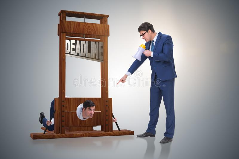 The businessman in deadline concept with guillotine. Businessman in deadline concept with guillotine stock photo