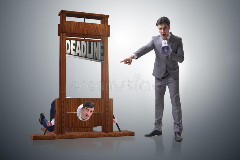 The businessman in deadline concept with guillotine royalty free stock photo