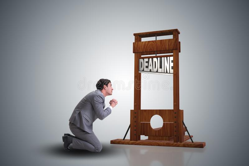 Businessman in deadline concept with guillotine royalty free stock photo