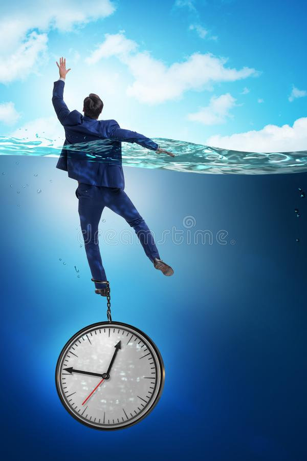 The businessman in deadline and time management concept stock images