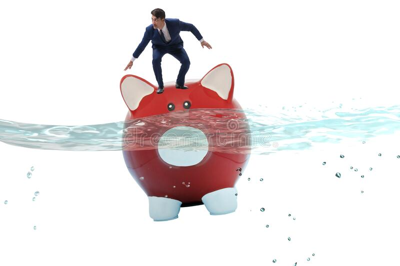 Businessman in debt concept with piggybank. The businessman in debt concept with piggybank royalty free stock images