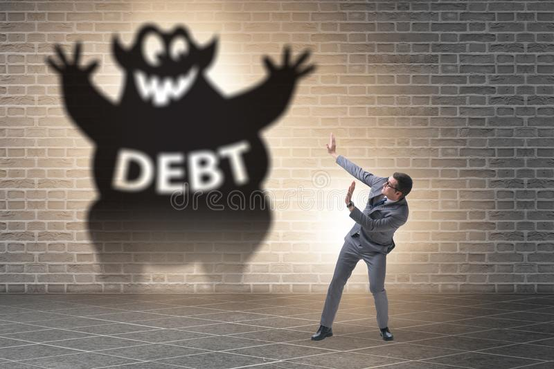 Businessman in debt and loan concept. Businessman in the debt and loan concept stock images
