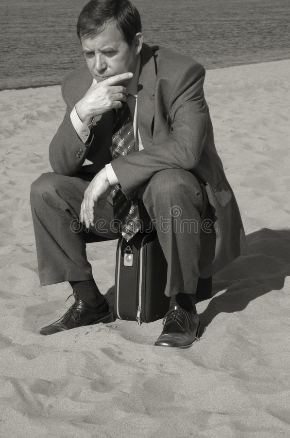 Businessman deep in thought stock photography