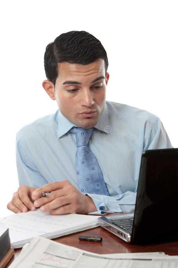 Businessman at desk working royalty free stock photography