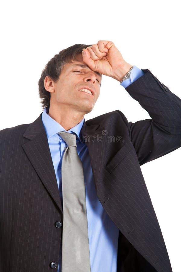 Businessman despairing. Emotional mature businessman isolated on white stock photos