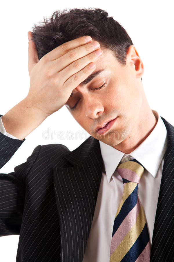 Businessman despairing. Emotional young businessman isolated on white royalty free stock photography