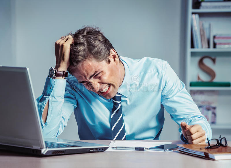 Businessman with desperate of facial expression, suffering, stress and headache. stock photo