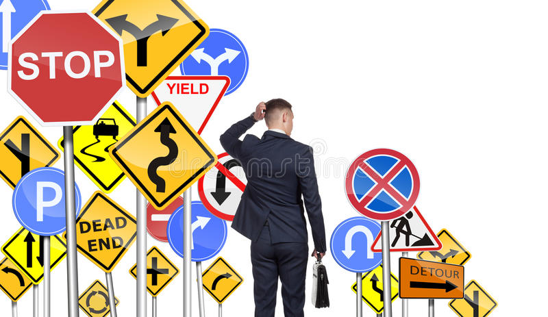 Businessman and difficulty of select the correct way stock photography