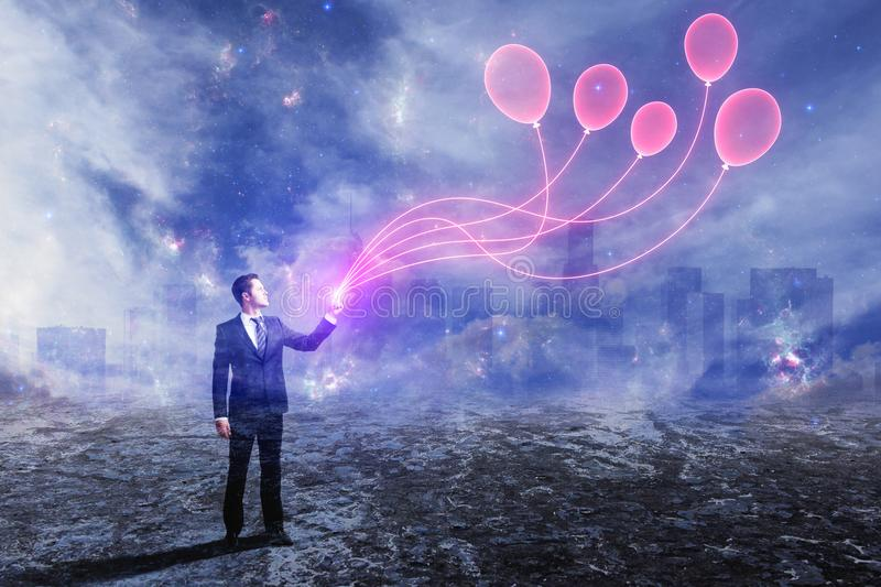 Businessman with balloons. Businessman with digital balloons on abstract outdoor background. Dreams concept. Double exposure stock photos