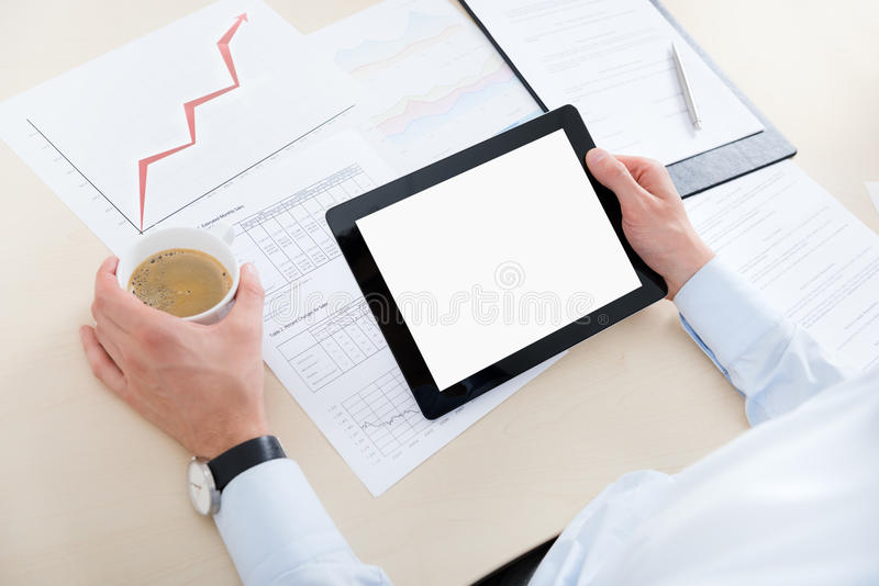 Businessman with digital computer royalty free stock photo
