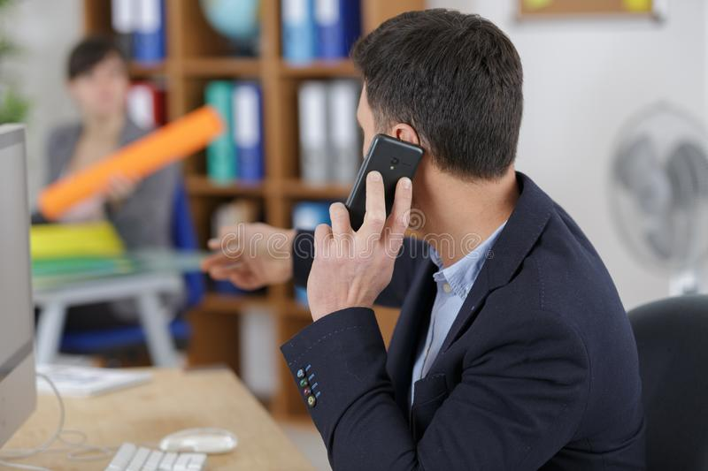Businessman with digital tablet and mobile phone stock photos