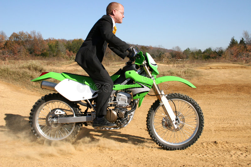 Businessman on Dirt Bike royalty free stock photography