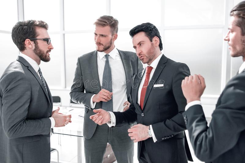 Businessman discusses important issues with the business team stock images