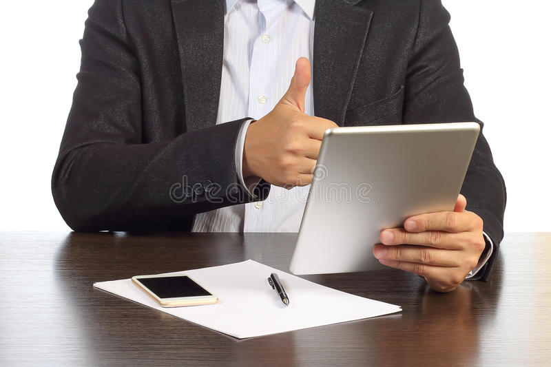 Businessman is discussing on video communication on tablet with business partners stock images