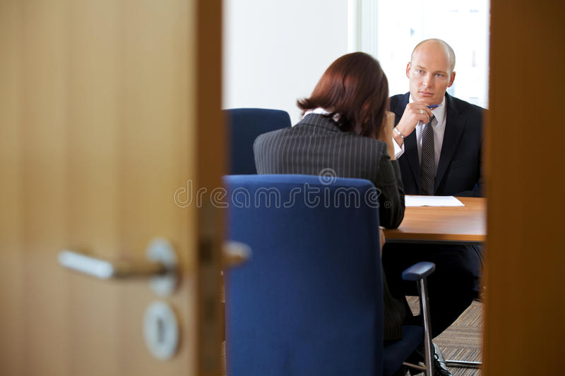 Businessman in discussion with businesswoman royalty free stock photo
