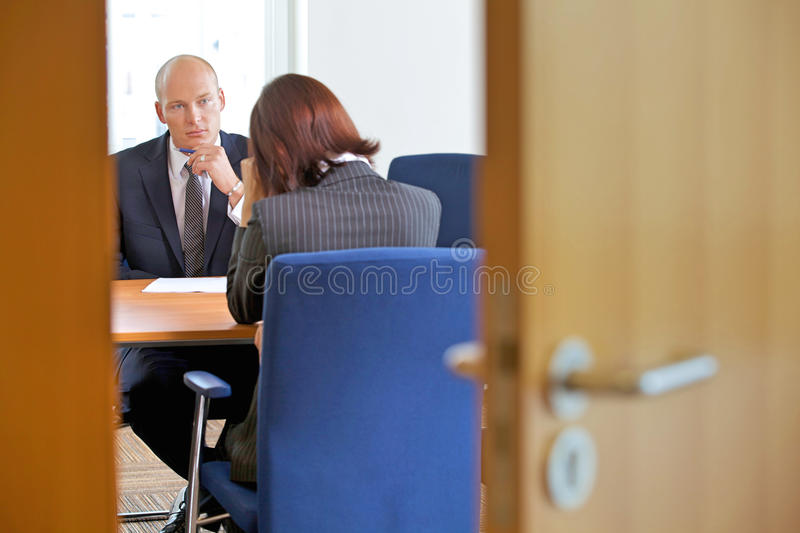 Businessman in discussion with businesswoman royalty free stock image