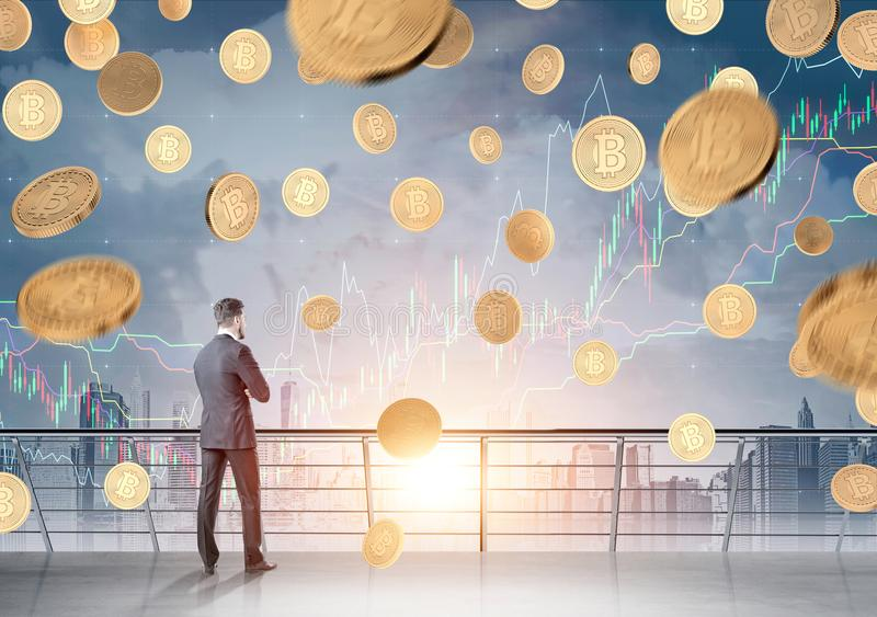 Businessman with a document, bitcoin rain, graphs. Rear view of a bearded young businessman in a dark suit looking at a bitcoin rain and red and green graphs in royalty free stock photography