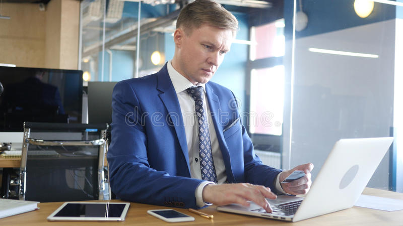 Businessman doing online shopping with credit card stock images