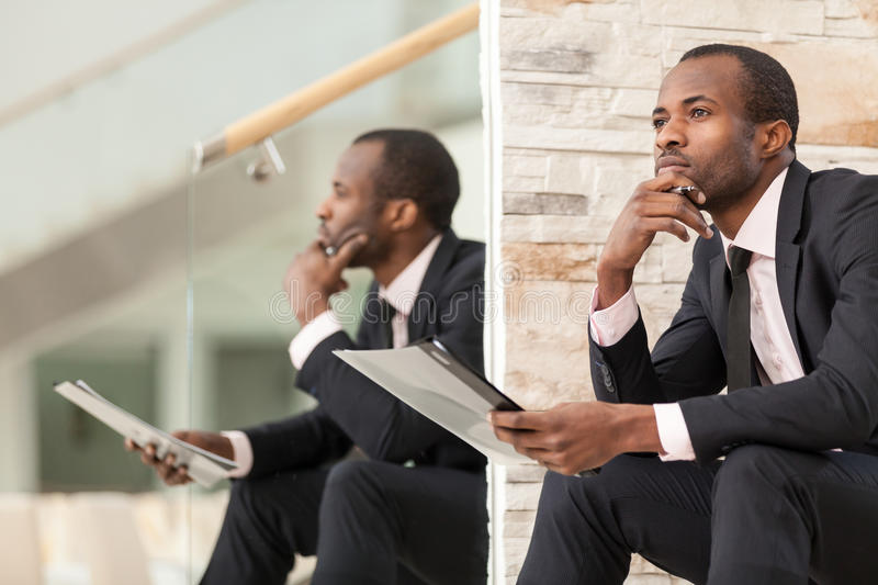 Businessman doing paper work royalty free stock image