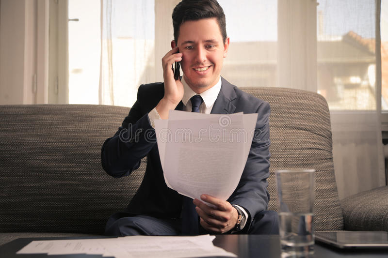 Businessman doing a phone call royalty free stock images