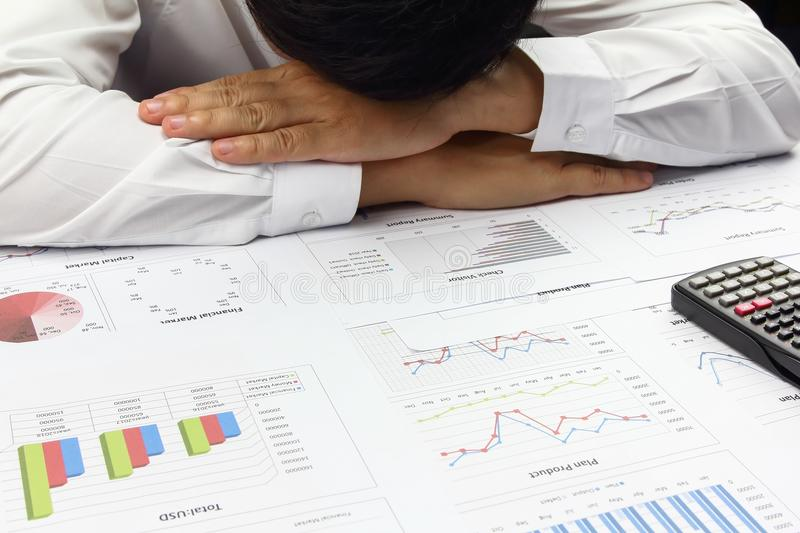 Businessman doing plan finance with calculate about cost . stock image