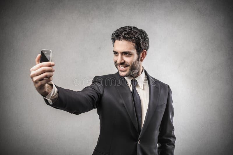 Businessman doing a selfie stock photo