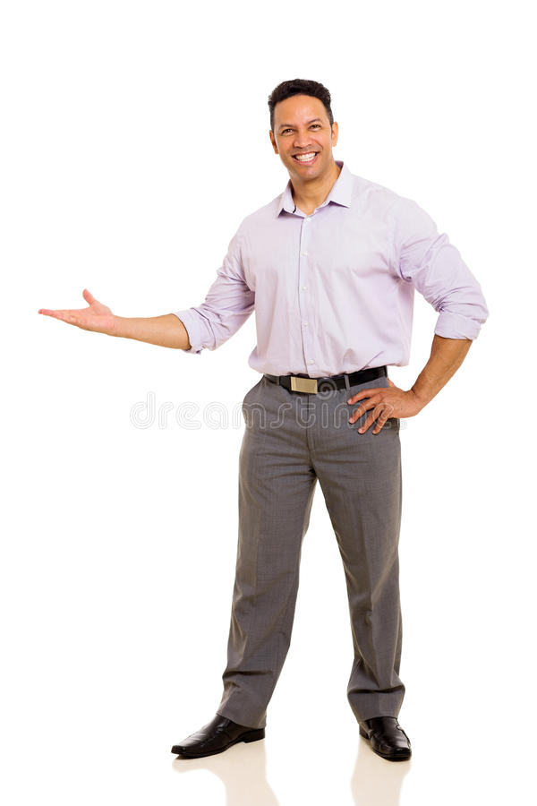 Businessman doing welcome gesture royalty free stock photo