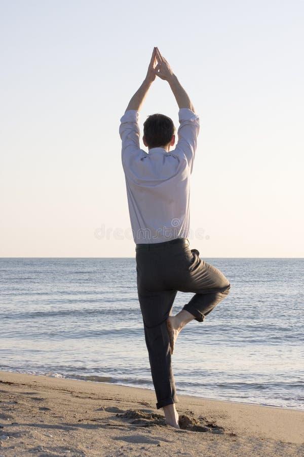 Businessman doing yoga royalty free stock images