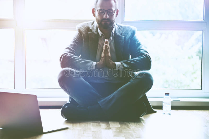 businessman doing yoga in lotus pose at office royalty free stock image