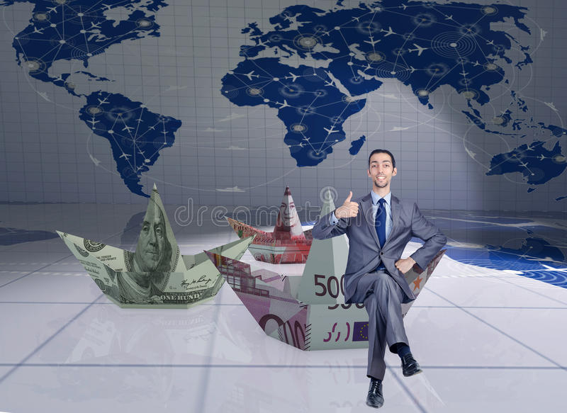 The businessman with dollar paper boats. Businessman with dollar paper boats stock photo