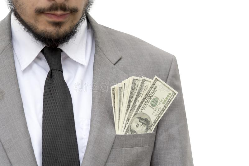 Businessman with dollars bills inside the pocket, concept of corruption royalty free stock image
