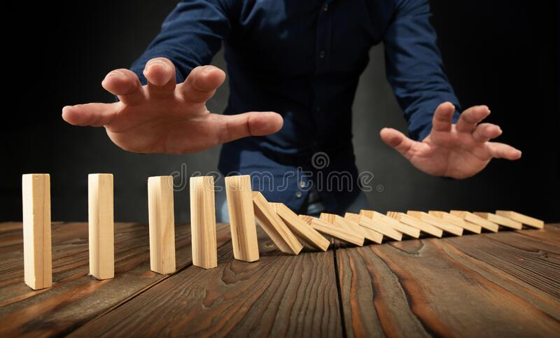 Businessman and Domino Effect Concept royalty free stock photo