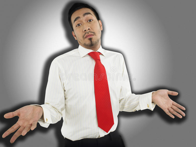 Businessman With Don't Know Gesture stock image