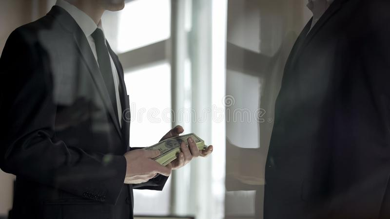 Businessman donating charitable contribution in cash, prosperity of business. Stock photo royalty free stock images