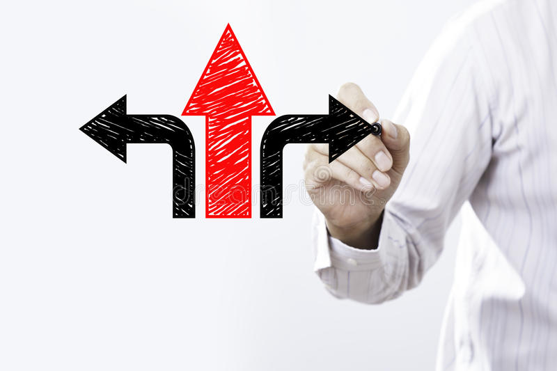 Businessman draw arrows. Decision or strategy concept royalty free stock image
