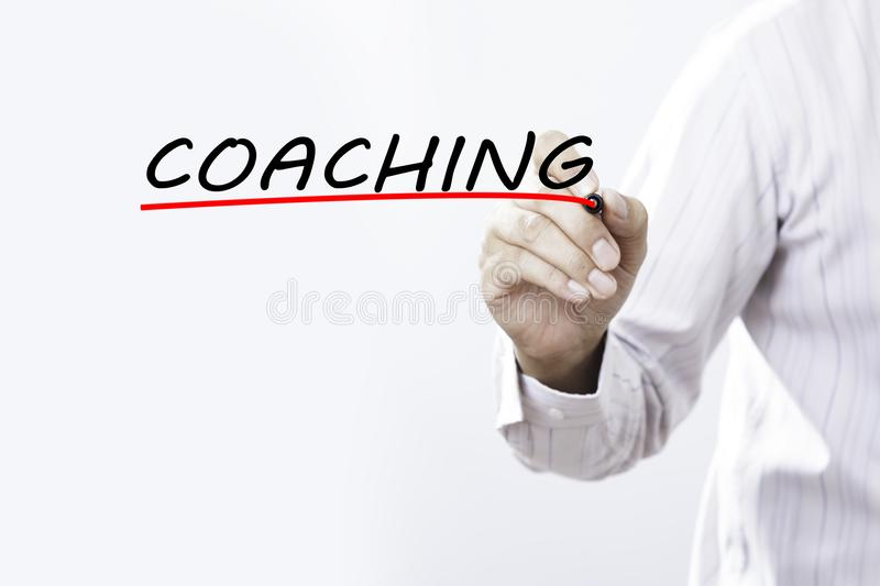 Businessman draw coaching word, Training Planning Learning Coach stock photo